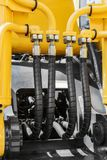 Hydraulics and fuel system yellow tractor Royalty Free Stock Photo