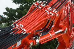 Hydraulics. Hydraulic Hoses and Tubes on Large Machinery Stock Photo