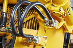 Hydraulics of machinery. Hydraulic pressure pipes system of construction machinery Stock Photo