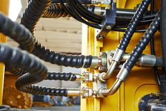 Hydraulics of machinery. Hydraulic pressure pipes system of construction machinery Stock Photography