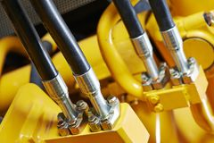 Hydraulics of machinery. Hydraulic pressure pipes system of construction machinery Stock Image