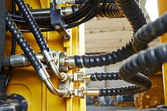 Hydraulics of machinery. Hydraulic pressure pipes system of construction machinery Stock Images