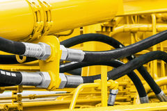 Hydraulics pipes and nozzles, tractor. Or other construction equipment. focus on the hydraulic pipes royalty free stock images