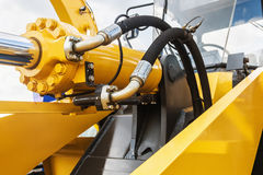 Hydraulics tractor yellow Stock Photos