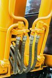 Hydraulics tractor yellow Royalty Free Stock Images