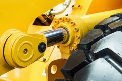 Hydraulics tractor yellow Stock Photography