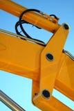 Hydraulisch element van een gele boom van een tractor Stock Foto's