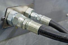 Hydrauliskt vattnar med slang Royaltyfri Bild