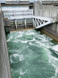 Hydro dam control weir with underneath discharge Royalty Free Stock Photos