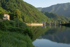 Hydro electric dam on the Serchio River. View from upstream of a hydro electric dam on the Serchio River near the town of Borgo a Mozzano, Italy stock images