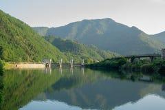 Hydro electric dam on the Serchio River. View from upstream of a hydro electric dam on the Serchio River near the town of Borgo a Mozzano, Italy stock photography