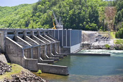 Hydro Electric Power-Generating Dam. A hydro electric power generating dam in the mountains stock photo