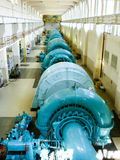Hydro-electric power. Turbines inside a hydro-electric powerplant, where water flow is turned into electricity Royalty Free Stock Photos