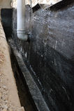 Hydro isolation of house. With bituminous waterproofing membrane Stock Image
