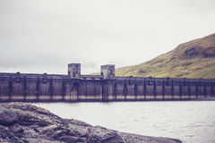 Hydro power dam in mountain landscape Royalty Free Stock Photography