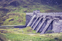 Hydro power dam in mountain landscape Stock Photo