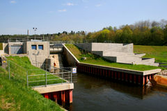 Hydro power plant. Hydroelectric power plant located on the river royalty free stock images