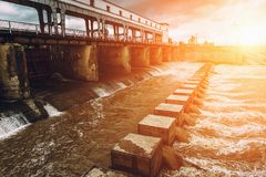 Hydro power plant at sunset. Toned Royalty Free Stock Photos