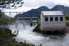 Hydro power station. Old hydro power station on the mountain river Royalty Free Stock Images