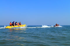 The hydrocycle tows the inflatable watercraft banana Stock Photos