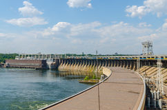 Hydroelectric dam. Bridge hydroelectric plant on blue sky background Stock Photos