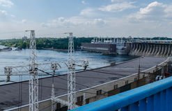 Hydroelectric dam. Bridge hydroelectric plant on blue sky background Stock Images