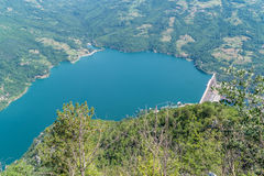 Hydroelectric Dam. This picture of the artificial lake and hydroelectric dam was taken with a height of a thousand meters from the mountain Tara in Serbia. The stock images