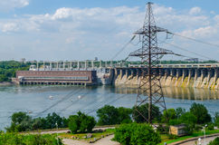 Hydroelectric dam. Hydroelectric plant on blue sky background Royalty Free Stock Photo