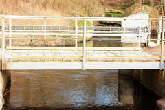 Hydroelectric dam. A small bridge spanning over the small hydroelectric dam in Djupafors, Sweden royalty free stock images