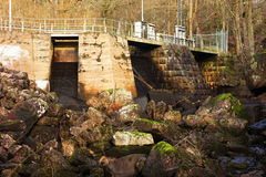 Hydroelectric dam. The small hydroelectric dam in Djupafors, Sweden. This is the downside where the riverbed is dry stock photo