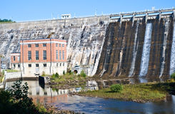 Hydroelectric Generator Plant. A large hydroelectric power plant on Lake Burton with water flowing over the dam around it.  Safe, clean and green, water power Royalty Free Stock Photography