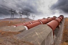 Hydroelectric plant in renewable energy concept. Global warming and renewable energy concept, penstock water pipes in a hydroelectric power plant on barren Royalty Free Stock Image