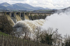 Hydroelectric Power. Dam generates hydroelectric power against background of clouds and Italian hillside stock photos