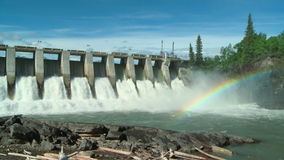 Hydroelectric Power Dam with Rainbow wide shot Royalty Free Stock Image