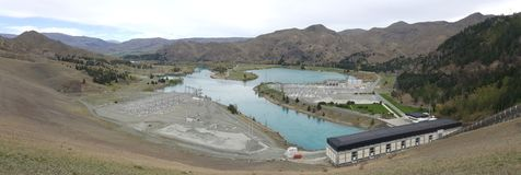 Renewable energy of hydroelectric power plant on river lake in Benmore Lake, New Zealand stock image