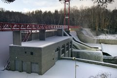 Hydroelectric power station. Wather is extremely cold (-18C), so the river (and tiny falls that are used to produce the electricity) is mostly frozen Royalty Free Stock Image