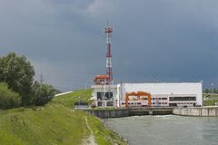 Hydroelectric Power Station. View of a hydroelectric power generating plant at the end of a canal royalty free stock image
