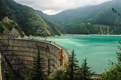 Hydroelectric power station with bright turquoise water stock images