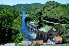 Hydroelectric power station. In paradisiacal environment Stock Photos