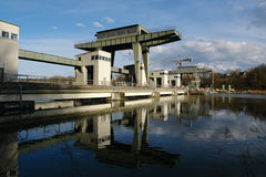 Hydroelectric power station on river Inn. Near the bavarian City Wasserburg .Blue Sky and Clouds as background royalty free stock photography