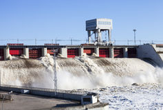 Hydroelectric power station. Spring flood water flowing on hydroelectric power station dam Stock Photography