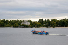 Hydrofoil vessel. Ships blue-orange coloring hydrofoil is on the Dnieper River in calm weather in the summer Stock Photography