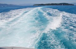 Hydrofoil wake, Corfu. The wake from the stern of a high speed hydrofoil ferry arriving in Kerkira harbour on the Greek island of Corfu royalty free stock photo