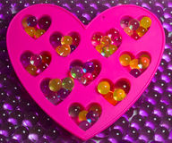 Hydrogel colored balls,  decorative heart. Hydrogel colored balls, beautiful background, decorative heart Stock Photography