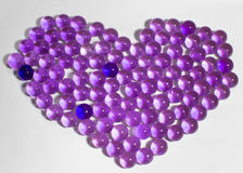 Hydrogel  purple beads in the shape of heart. Hydrogel lilac, purple beads in the shape of heart Stock Photos