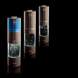 Hydrogen AA (R6) Batteries. Concept for a hydrogen household fuel cells. AA batteries with compartment filled with bubbling water. Regular and ultra power Royalty Free Stock Image