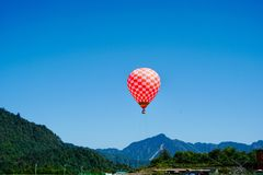 Hydrogen balloon floating in the mountains stock images