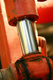 Hydrolic Piston Vertical. Close up shot of a hydrolic piston in a small earth mover Royalty Free Stock Photography