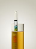 Hydrometer in Homebrew. A hydrometer is shown floating in a test tube full of wort, the sugar rich liquid that is fermented into beer.  The hydrometer is Stock Photography