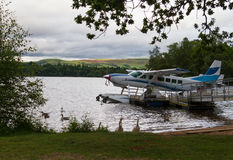 Free Hydroplane And Ducks At Lake Shore In Loch Lomond Stock Photography - 73712182